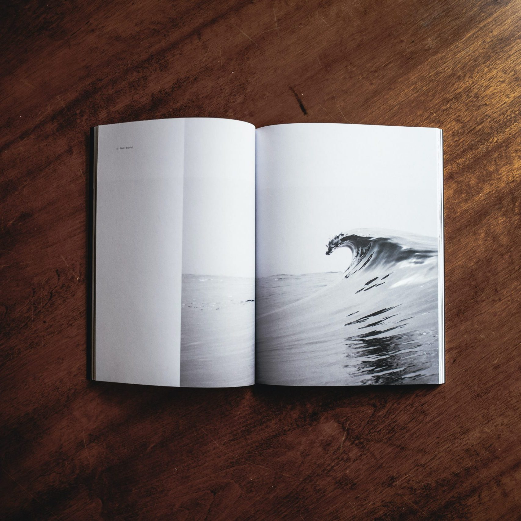 Andrew Neel - Unsplash - picture of wave in a book